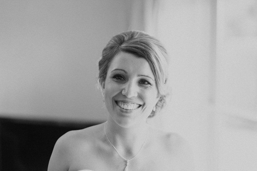 Black and white portrait of bride smiling