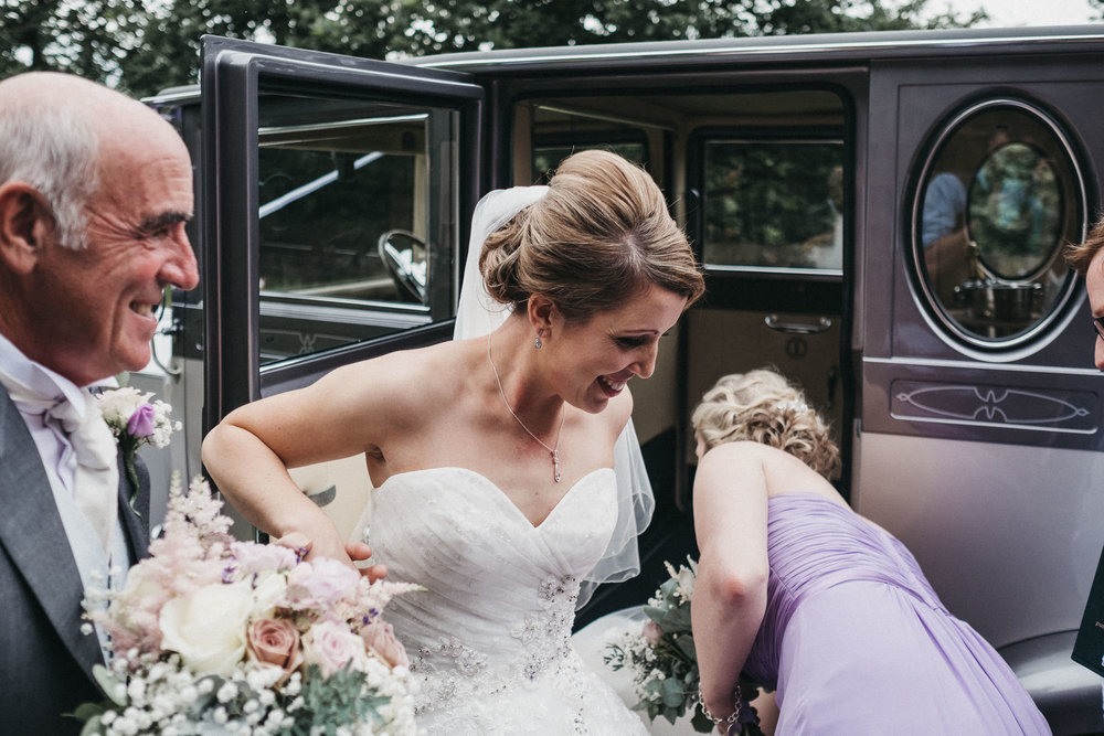 Bride gets out of car at St George's church