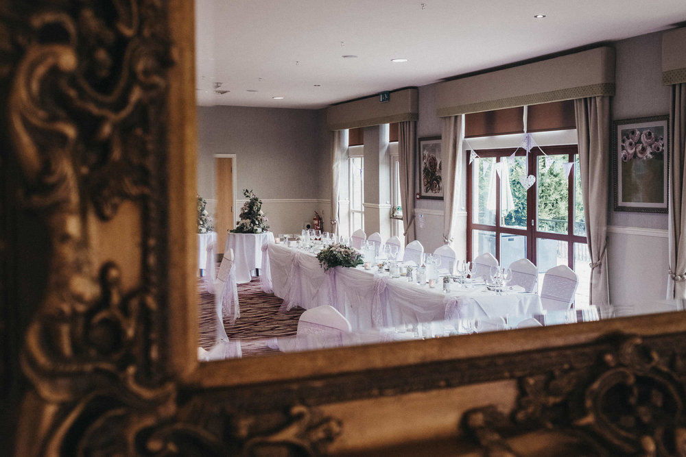 Reflection of wedding reception room at Bagden Hall