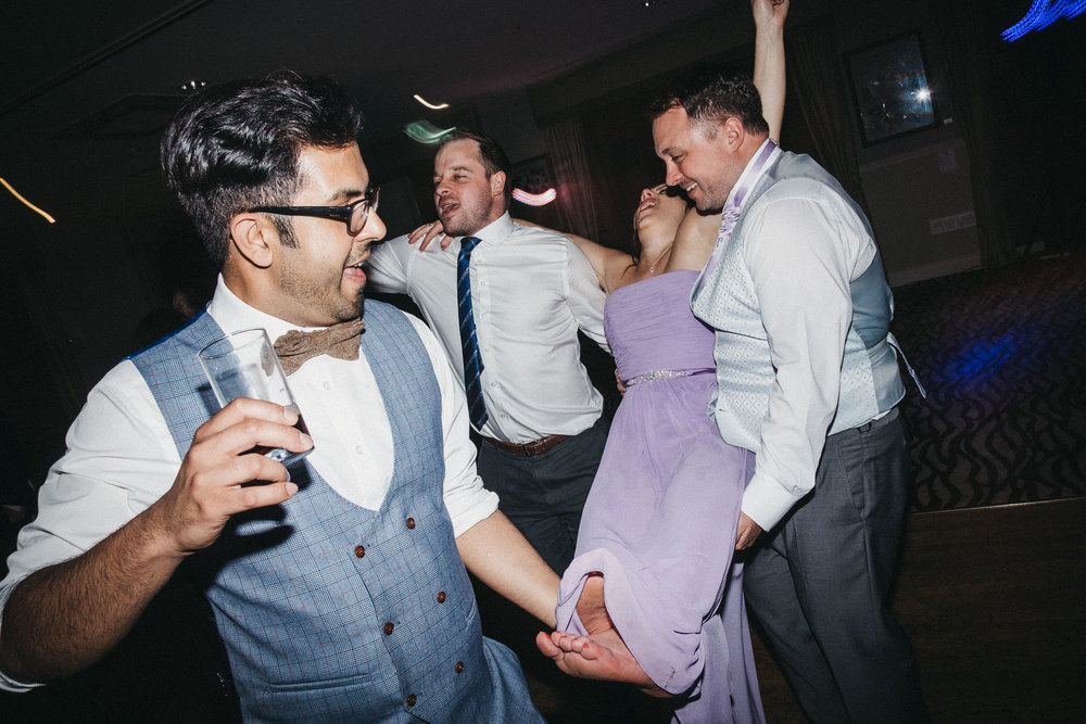 Guest carrying bridesmaid onto dance floor