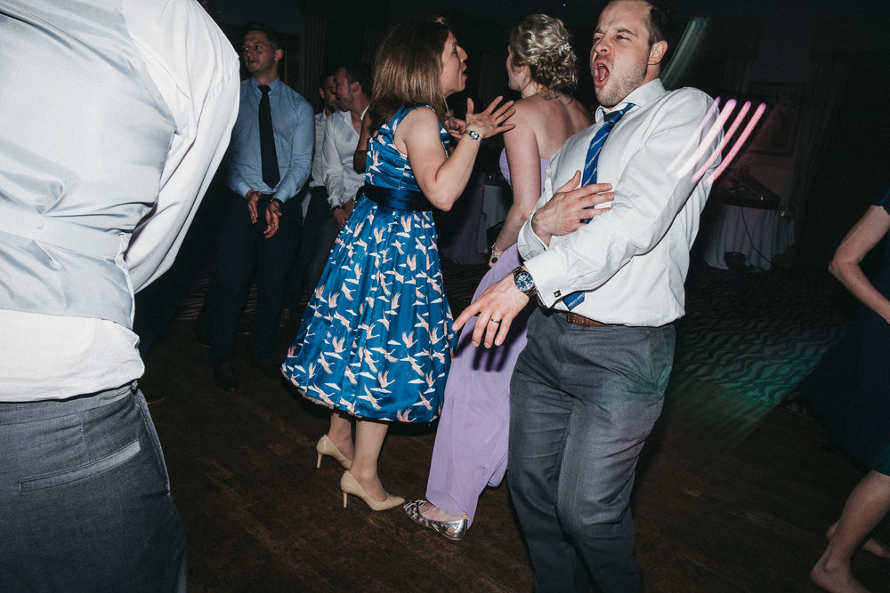 Groomsman pulls funny dance moves at wedding party