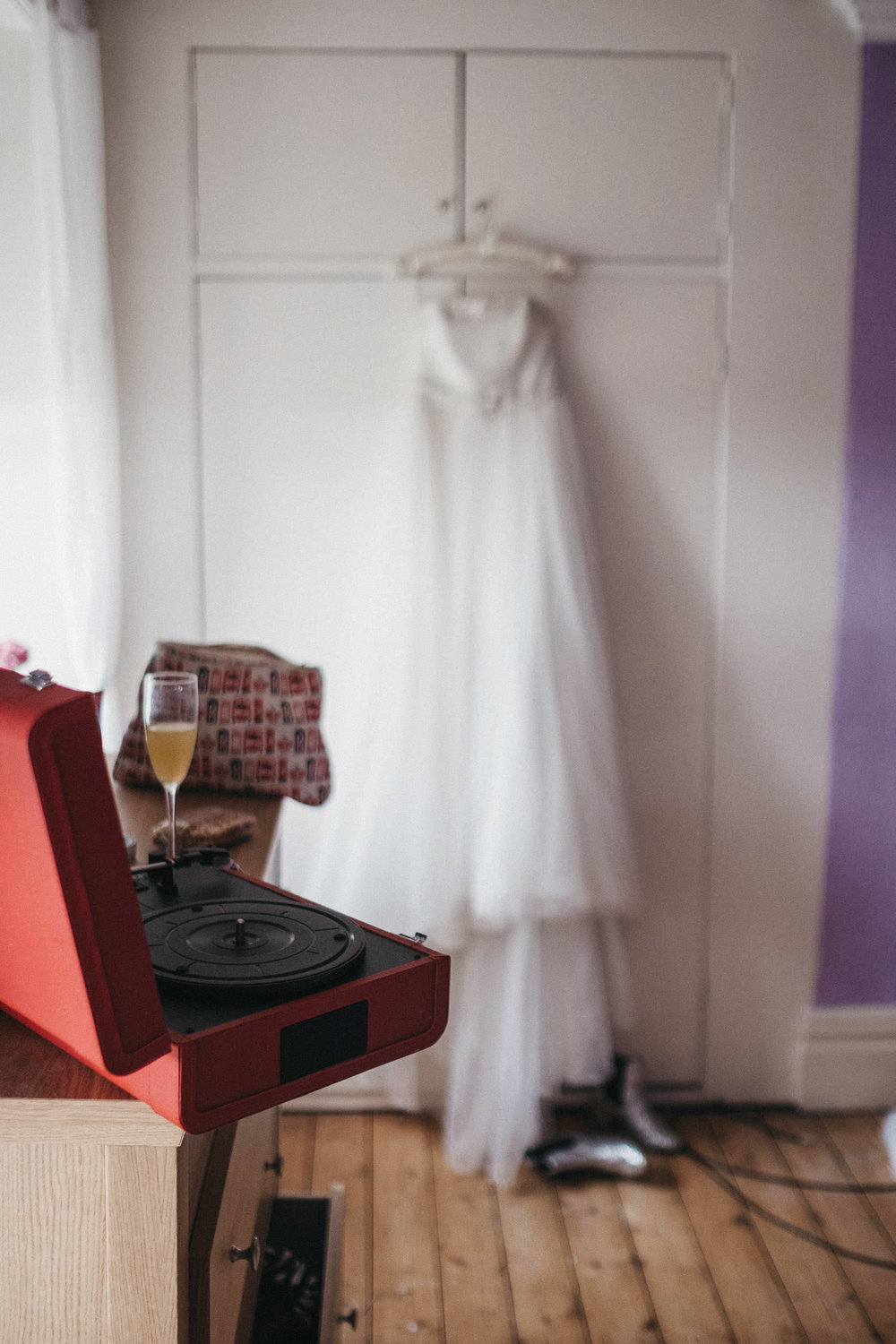 Bucks Fizz on record player with wedding dress in background