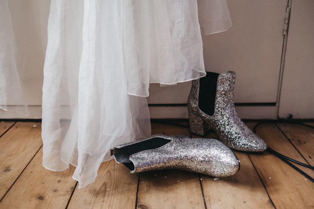 Detail shot of glittery boots under wedding dress