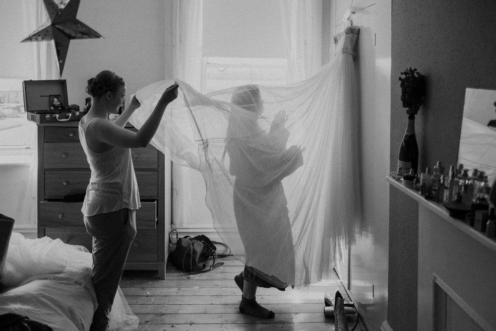 Black and white photo of bride under wedding veil