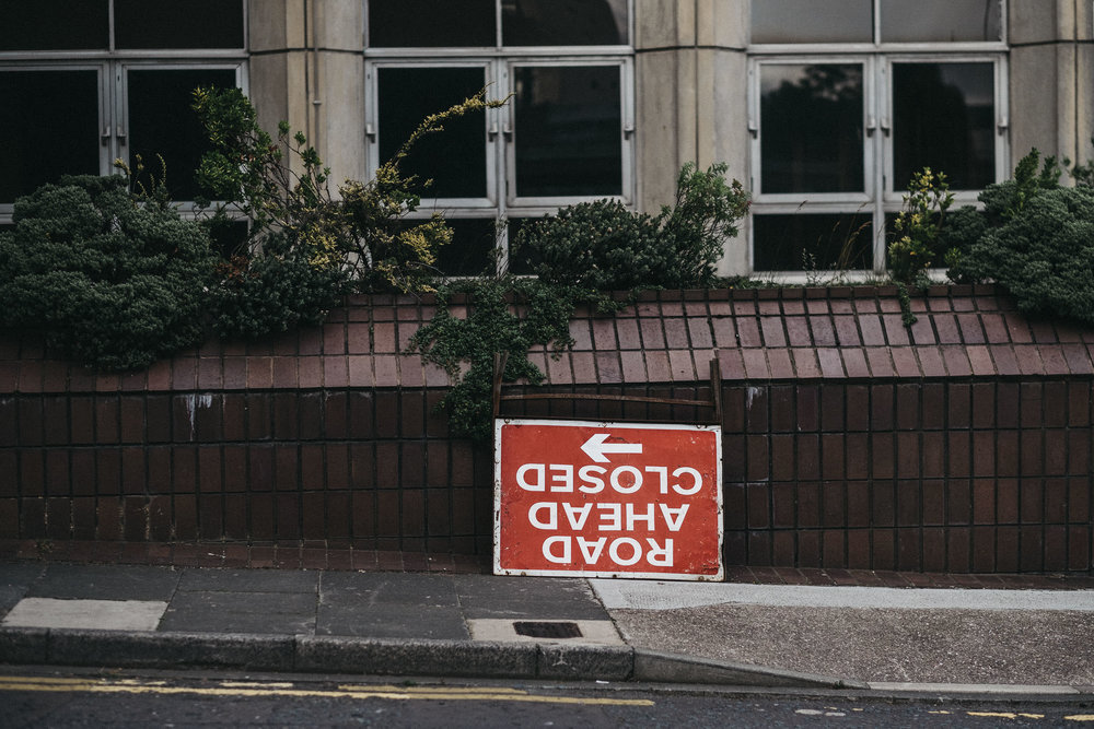 Funny photo of upside down road sign outside wedding venue