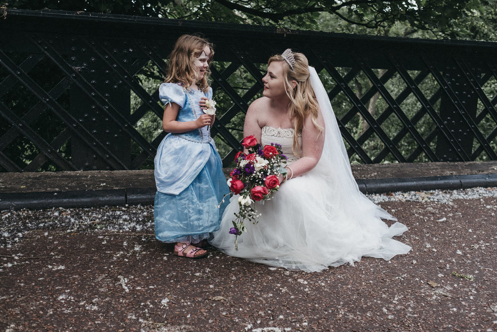 Bride chats with young girl in fancy dress