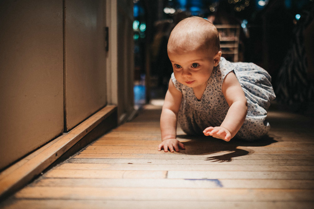 Baby crawls on floor at wedding at As You Like It