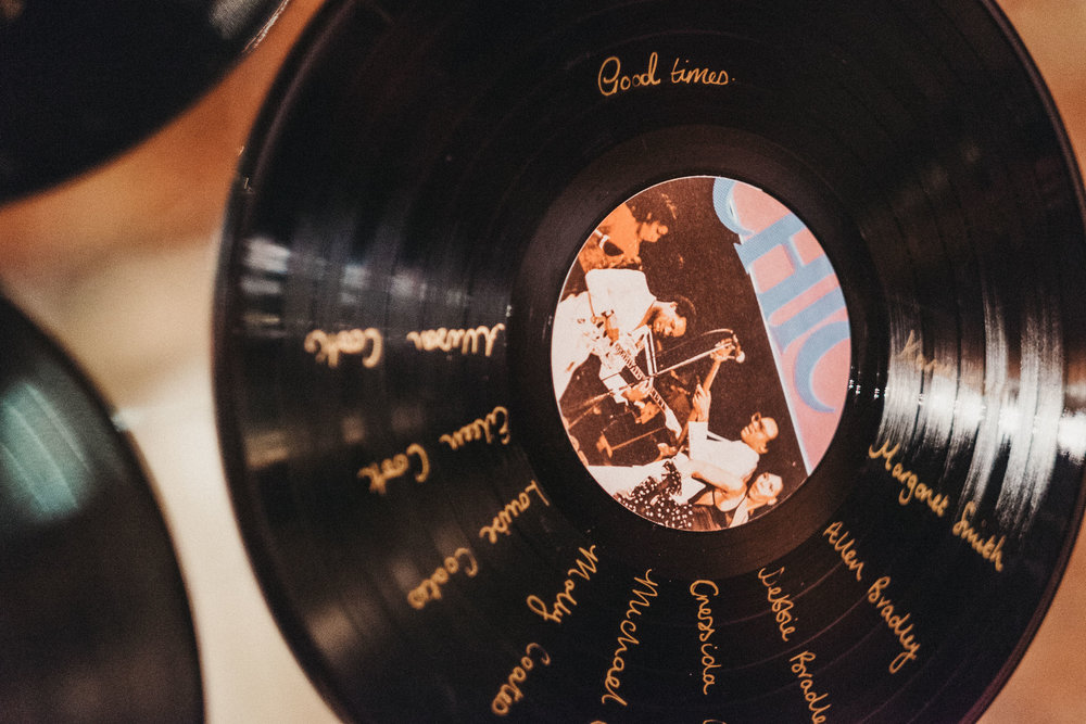 Close up of vinyl record table setting at wedding