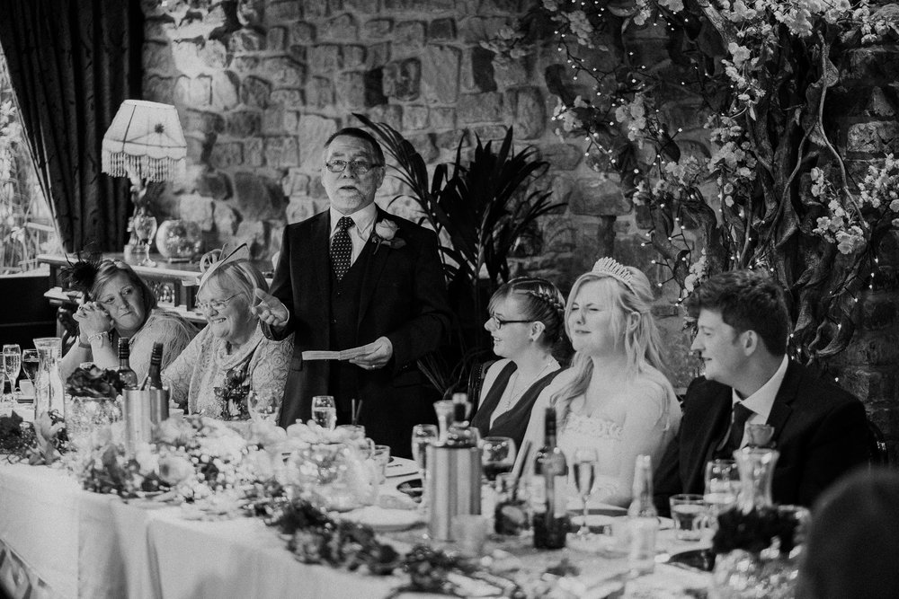 Black and white photo of father of the bride giving speech