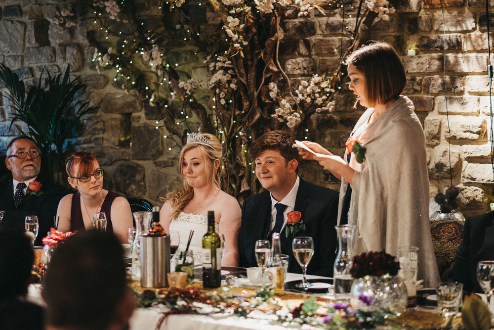 Bride and groom pull funny face during wedding speeches at As You Like It
