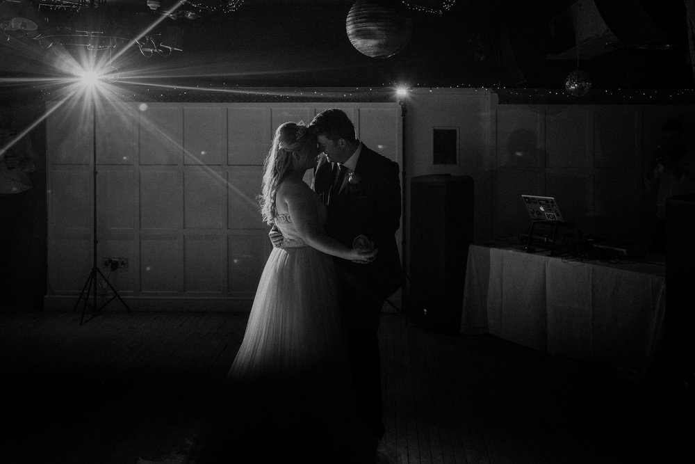 Black and white romantic photo of bride and groom first dance