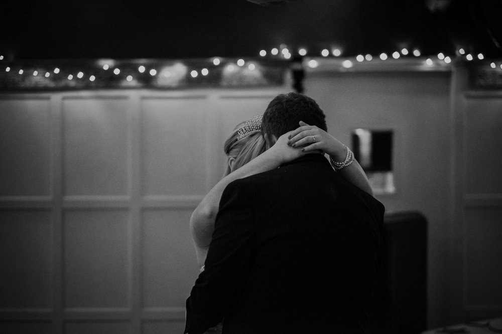 Black and white photo of close up of brides hands during first dance