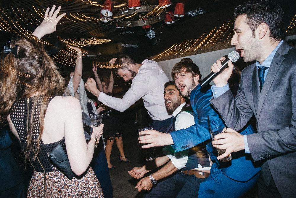 Wedding guests dancing wildly on dance floor
