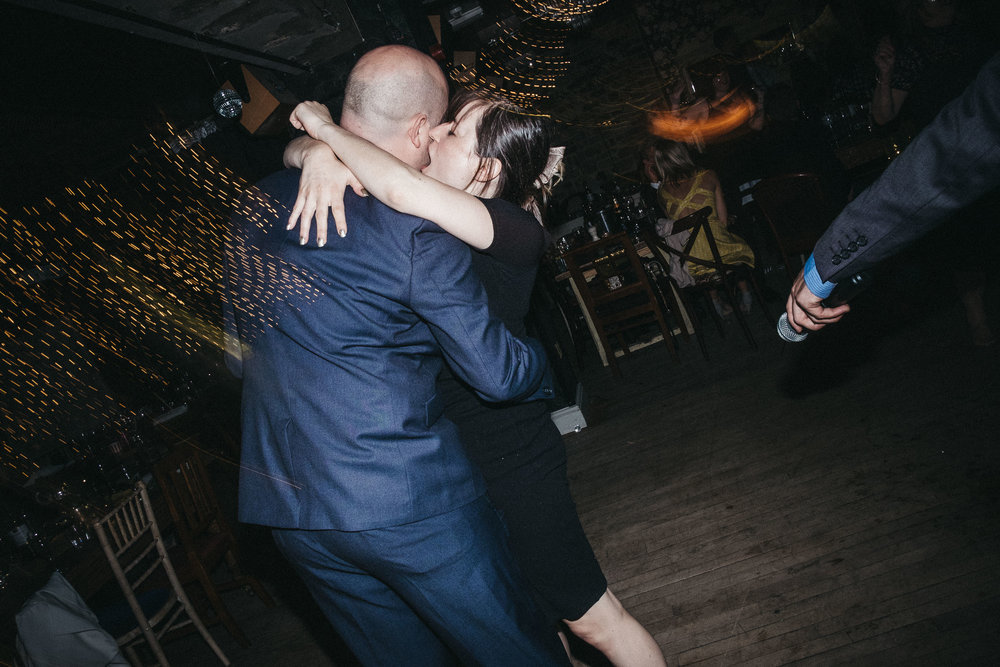 Wedding guest bites partners face while dancing