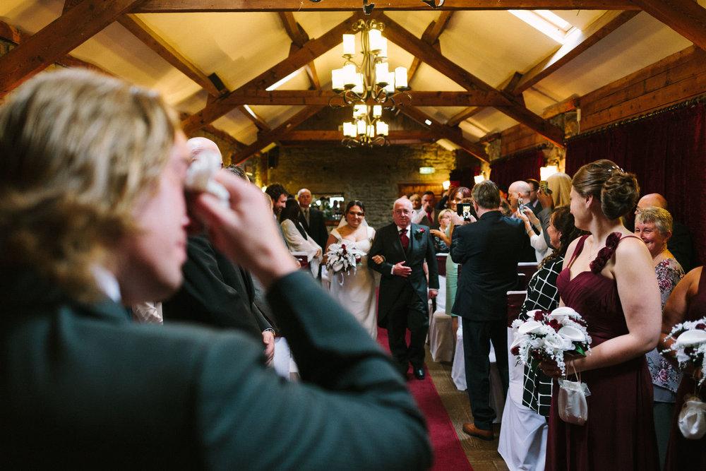 Groom cries as the bride arrives