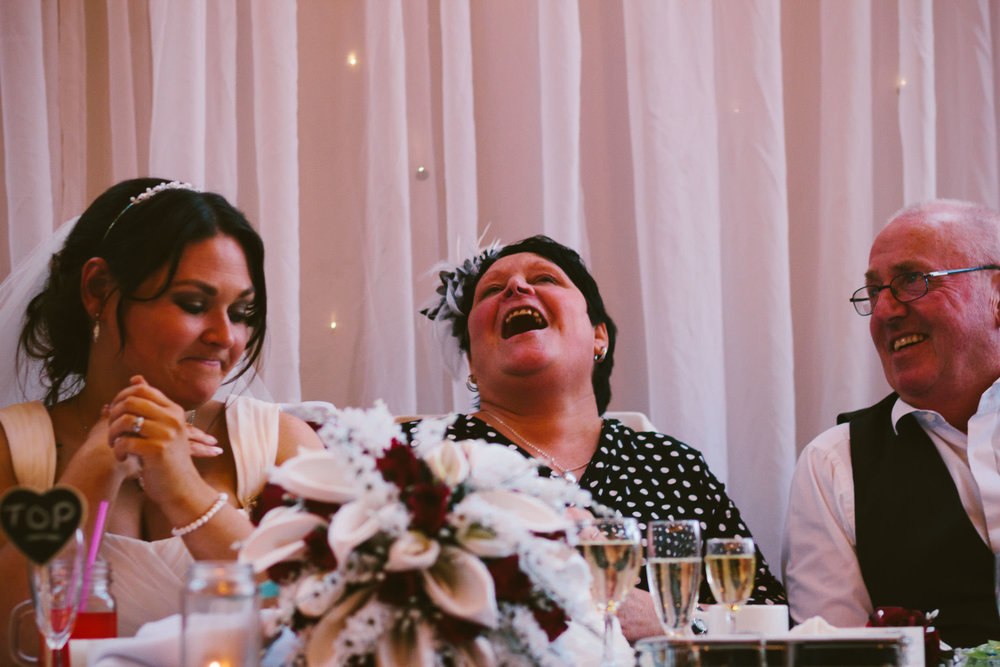 Mother of the bride laughs during speeches