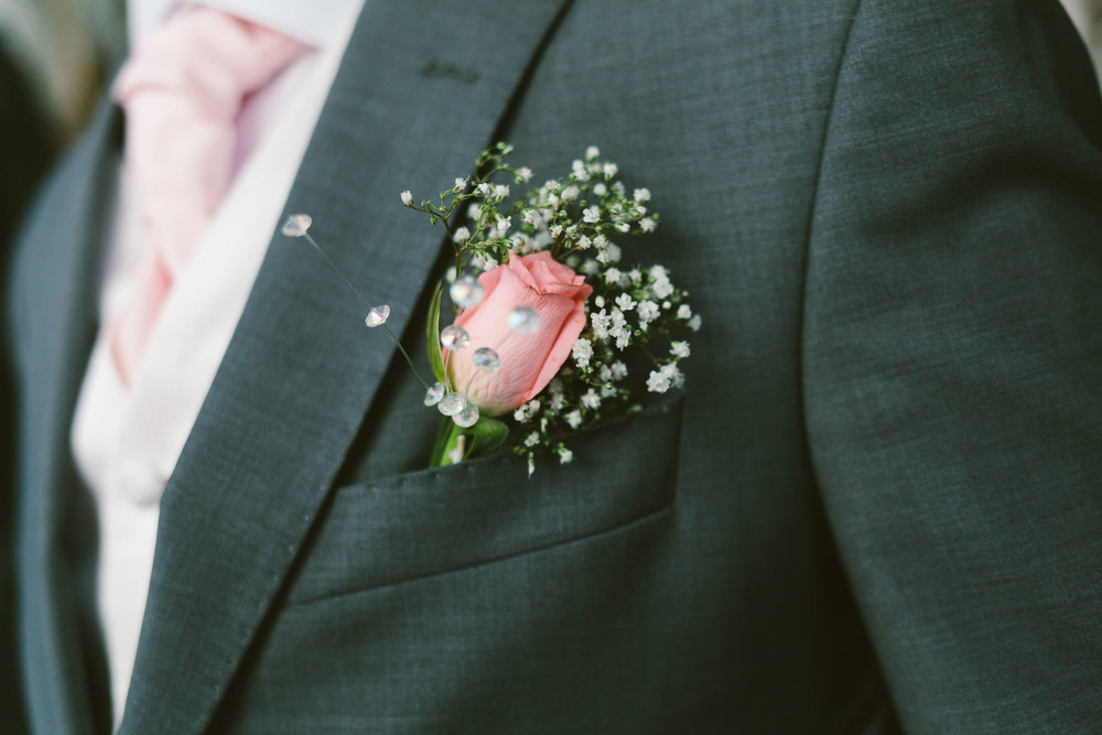 Close up of groom's flower