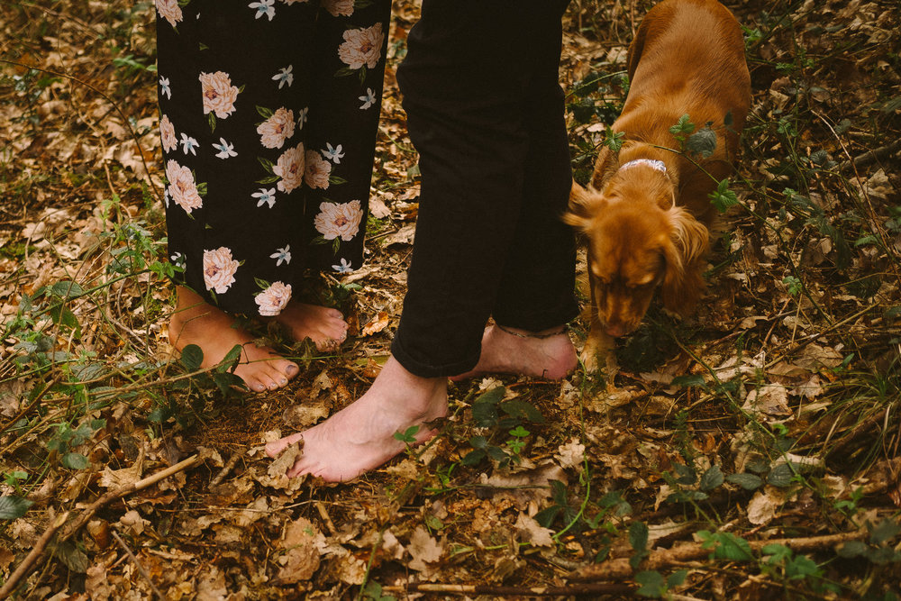 Engaged couple go barefoot on their pre-wedding shoot in the woods