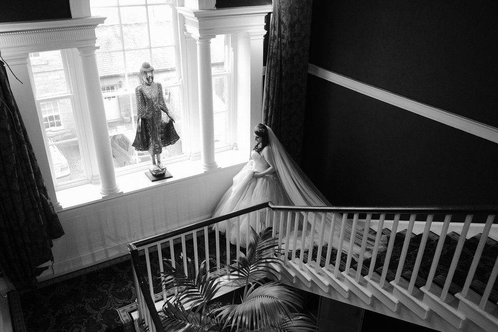 Tanya descending the grand staircase at Newton Hall