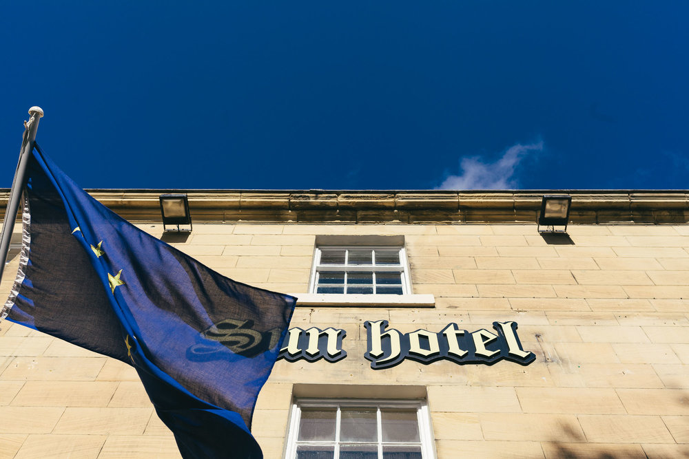 Sun Hotel sign and flag