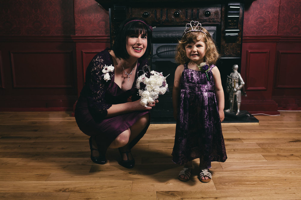 Bride poses with smiling child before her wedding