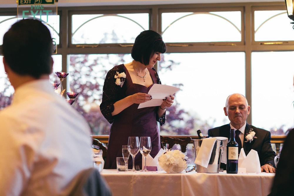 Bride reads wedding speech to groom