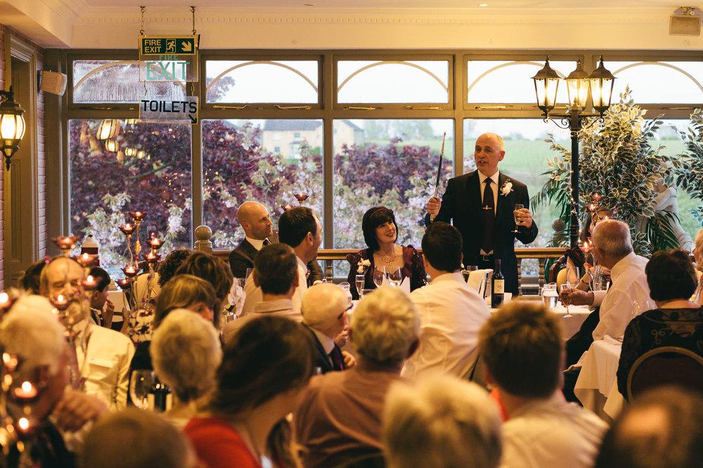 Groom brandishes sword during wedding speech