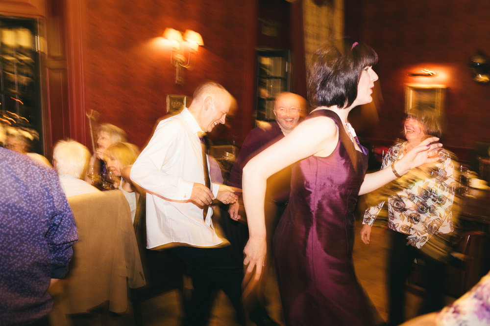 Bride and groom make funny shapes as they dance