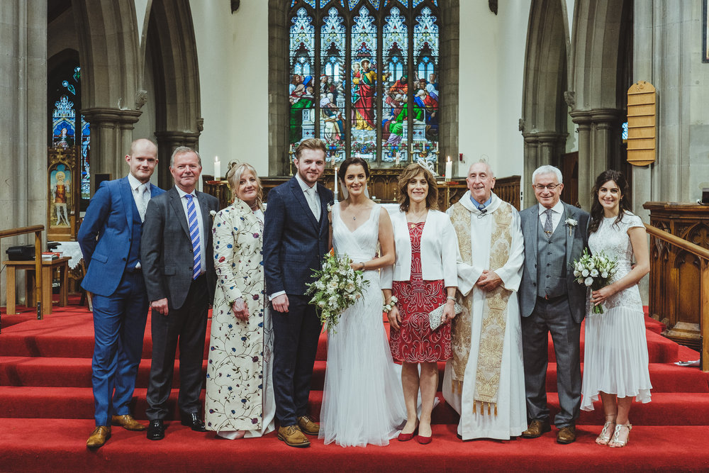 Noor and Callum's wedding took place on a rainy day, so we used the interior of the church to get some lovely group shots with a nice backdrop