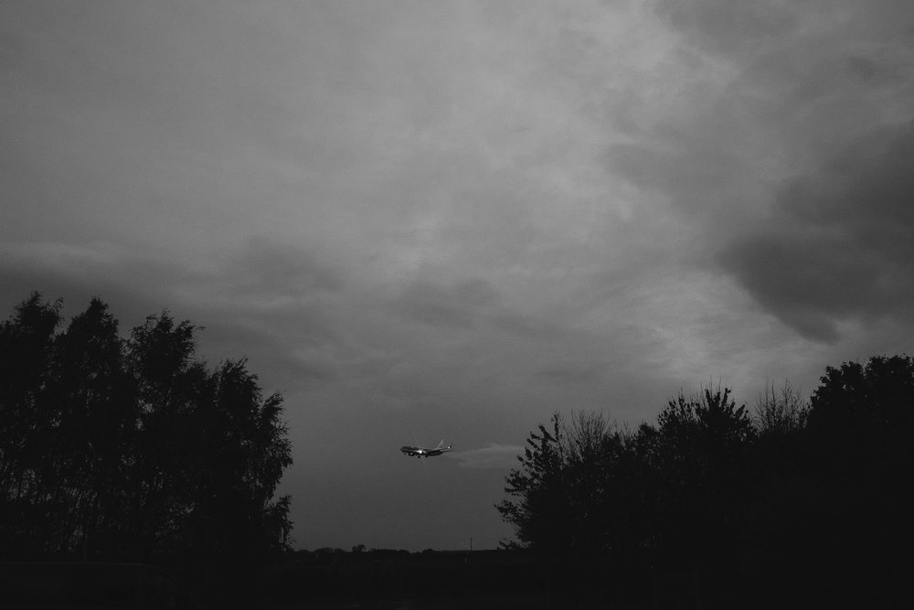 A black and white photograph of a plane landing near Havannah Nature Reserve in Newcastle