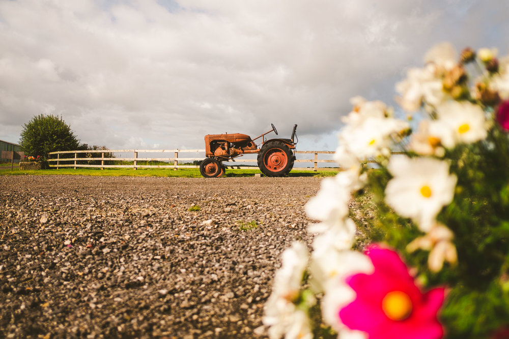 A rusted old tractor is a popular photo opportunity for wedding photographers and guests alike