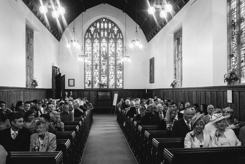 A black and white photo of the interior of St Oswin's church, Wylam