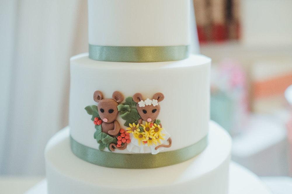 Wedding cake close up of field mice decorations