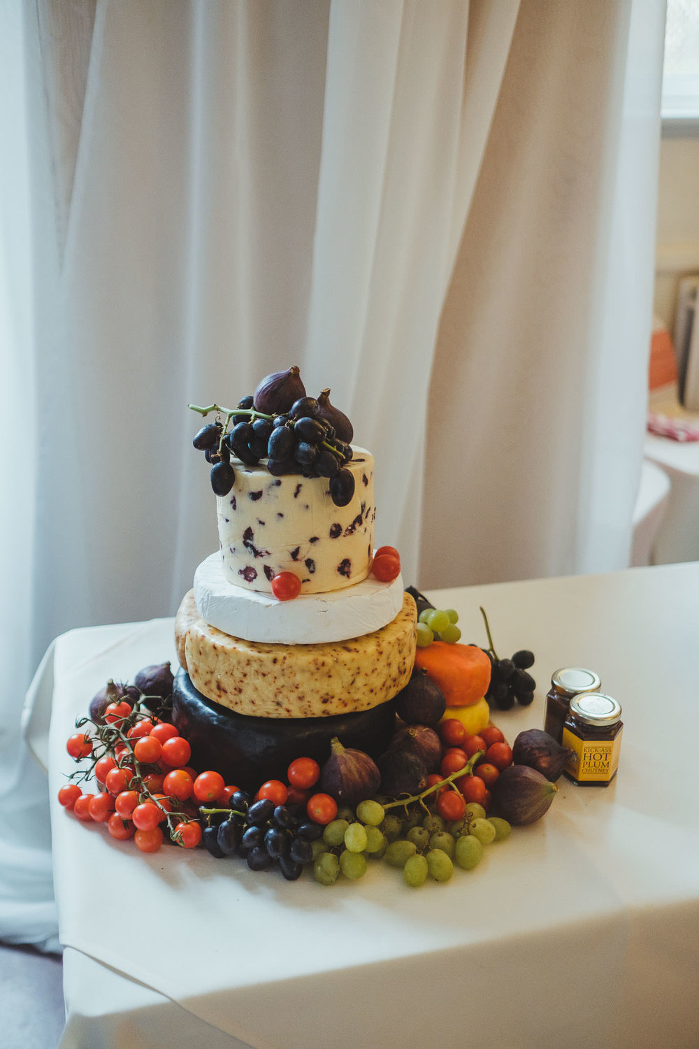 Close up of the cheese wheel alternative to wedding cake