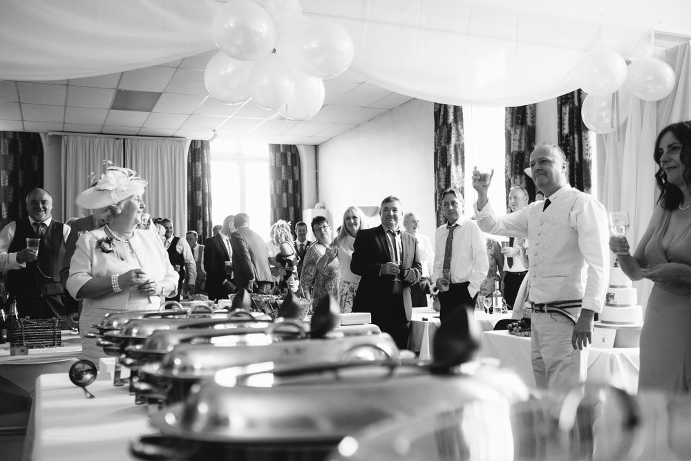 A black and white photo of a wedding speech at the Wylam Institute