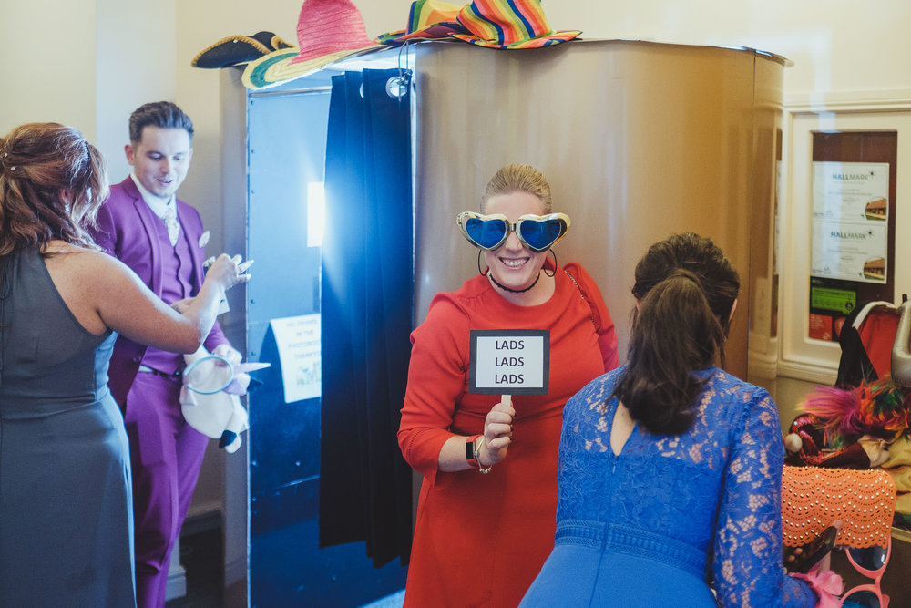 Wedding guests dressing up for a Photo Booth