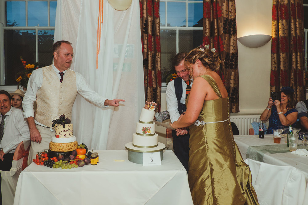 Wedding cake collapses as bride and groom cut the cake