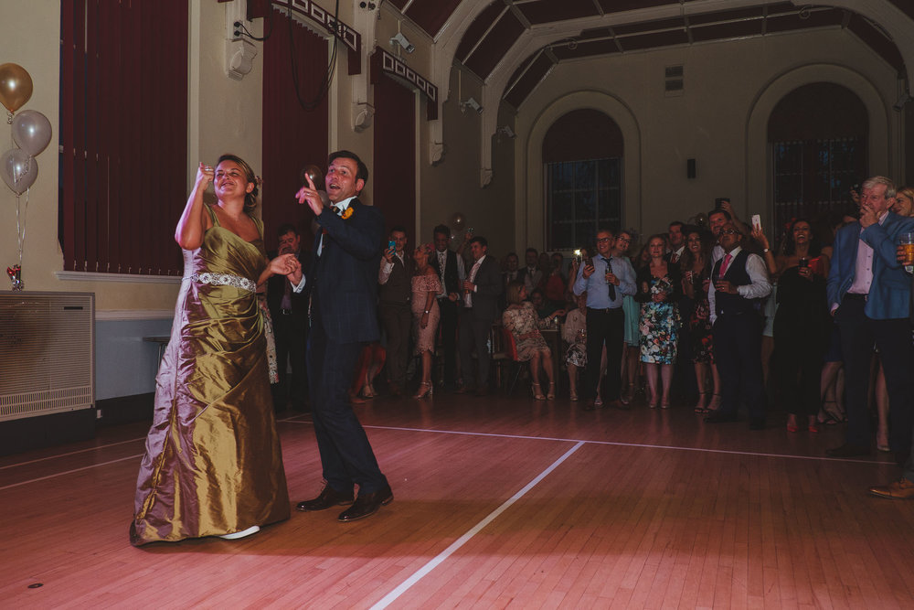 Bride and groom talk to the band during their first dance