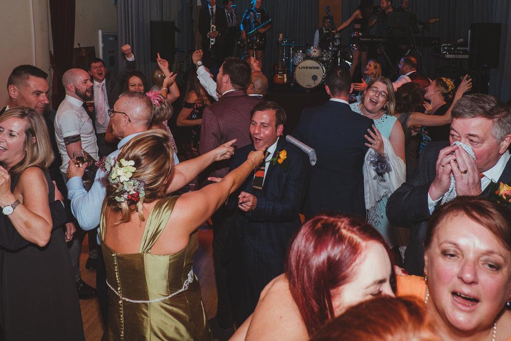 Bride and groom dancing amongst their wedding guests