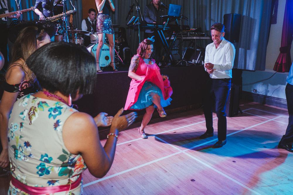 A wedding guest dances burlesque