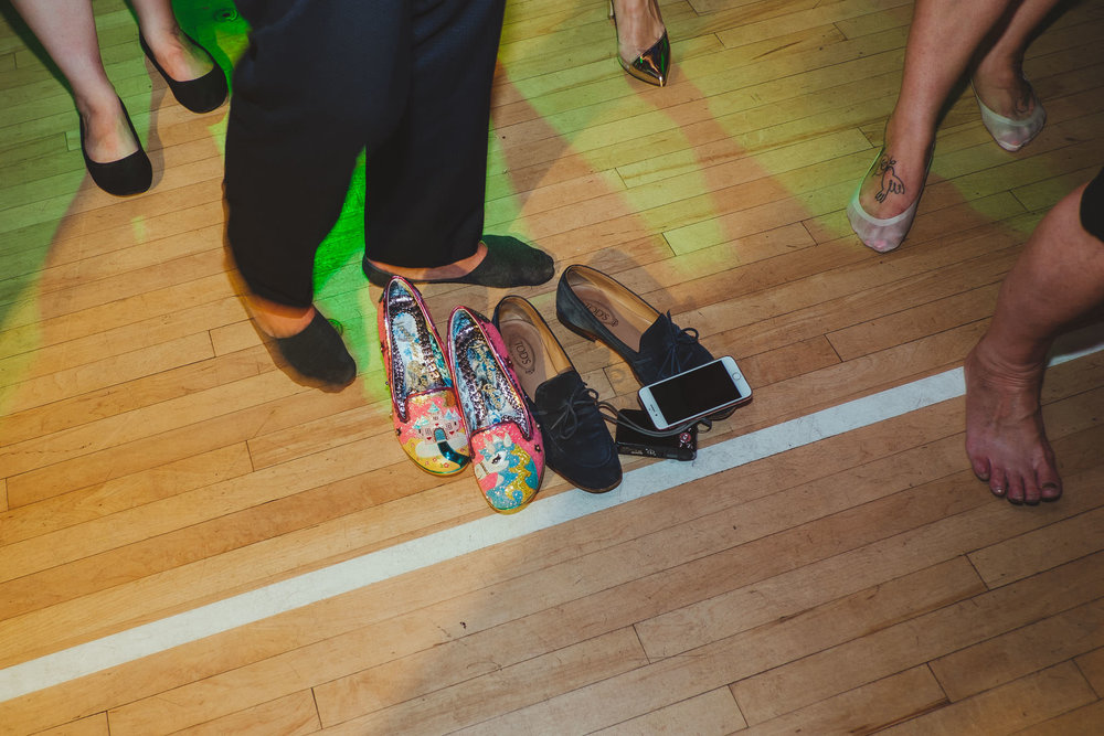 Shoes and phones abandoned on the dance floor as wedding guests dance barefoot