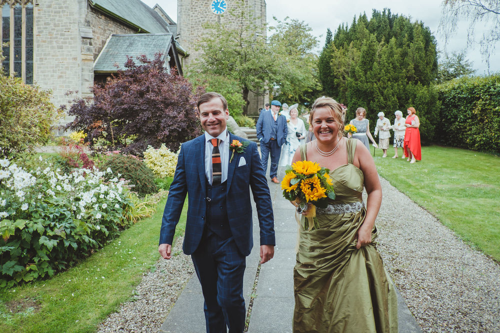 Emma wore an olive green wedding dress and Paul wore a Peaky Blinders inspired suit