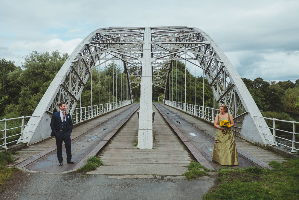 Emma and Paul at Wylam Railway Bridge at Hagg Bank - a unique location for bride and groom portraits