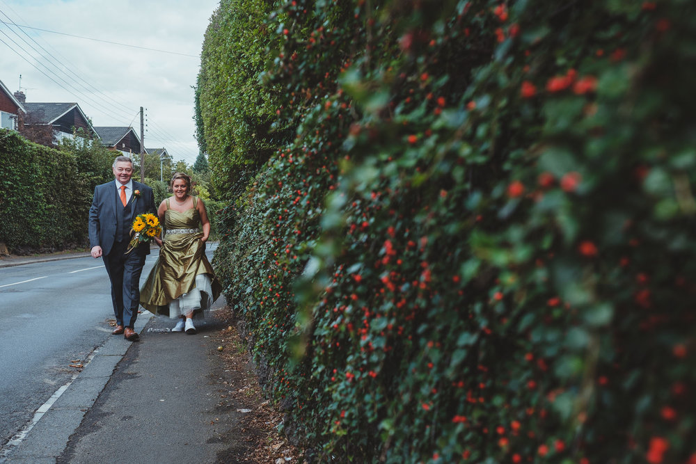 Emma and her dad walking to the church in Wylam