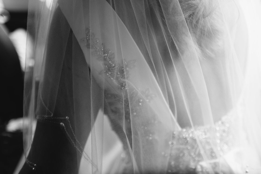 A black and white close up photo of the bride's wedding dress