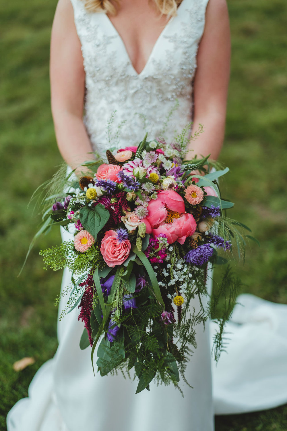 A close up of the colourful bride's flowers