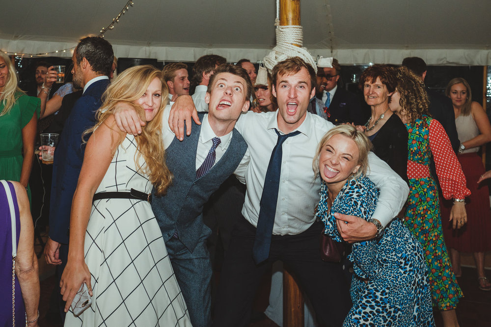 Wedding guests pull funny faces on the dance floor