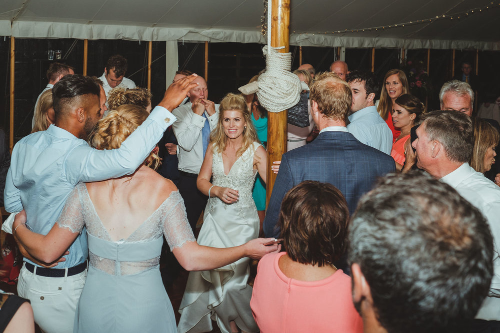 The bride dances around a pole on the dance floor