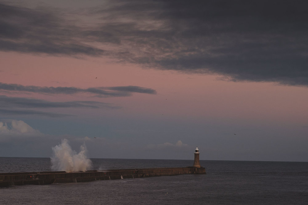 Waves smash against the harbour wall at Tynemouth Newcastle
