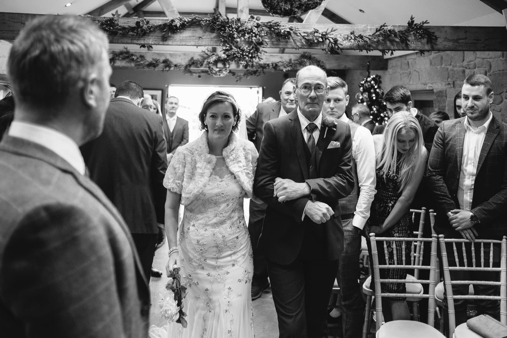 Black and white photo of the bride arriving at her ceremony at The Parlour at Blagdon